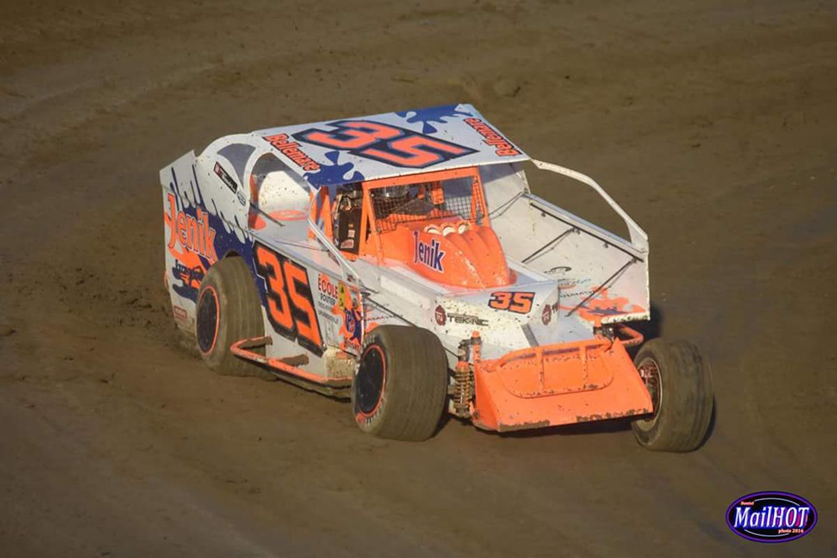 Eric Landry, driving race car sponsored by JENIK